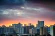 Sunset over urban concrete jungle - residential buildings in Honolulu, Hawaii - on a cloudy day