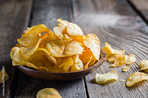 Potato chips on a wooden table