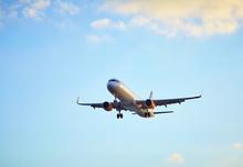 Flying Airplain Over Blue Sky