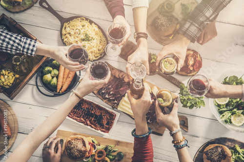 Group of people having meal togetherness dining toasting glasses Canvas Print
