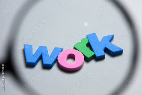 WORK, word written on white background with colorful letters under magnifying glass Wallpaper Mural