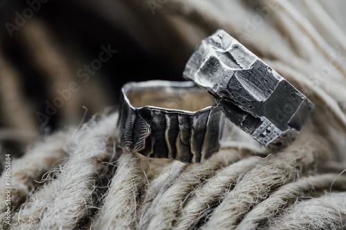 Ethnic wedding rings are handmade on the background of dreadlocks of hair Wallpaper Mural