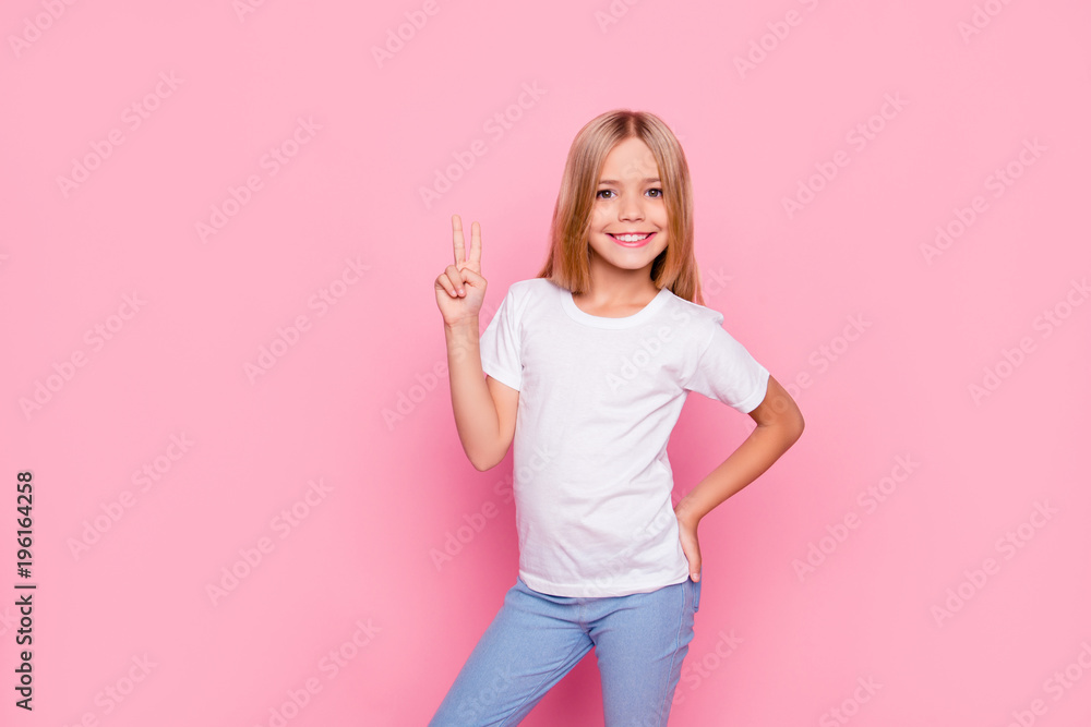 Fototapeta Fun joy enjoy people person funtime concept. Portrait of cute lovely carefree confident sweet adorable beautiful girl in casual modern outfit demonstrating v-sign isolated on pink background