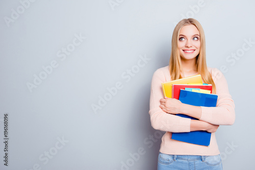 Teen age fashion hair casual clever a-student concept. Portrait of cute beautiful intelligent excited cheerful curious teenager freelancer embracing book in hands isolated on gray background copyspace