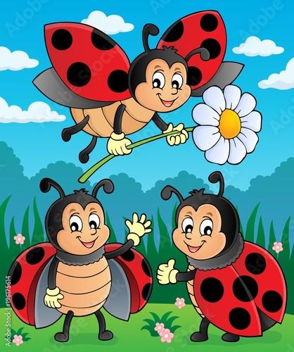 Naklejka premium Happy ladybugs on meadow image 2