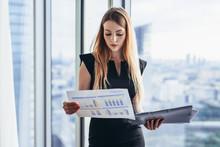Female Financial Analyst Holdi...