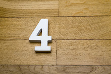 Number Four On A Wooden, Parquet Floor.
