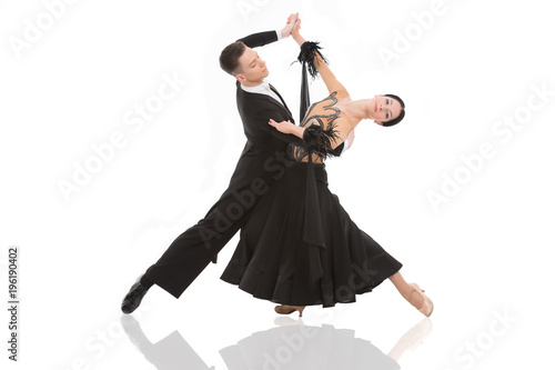 Foto op Canvas Dance School ballroom dance couple in a dance pose isolated on white