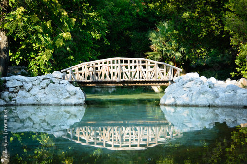 wooden bridge in the Athens National Garden , known as the Royal Garden , Greece