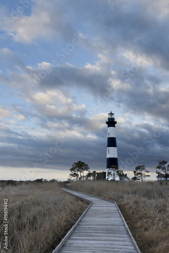 Fotografie, Obraz  Dramatic Clouds at Sunset - Bodie Island Lighthouse