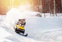 Snowmobile. Snowmobile Races In The Snow. Concept Winter Sports, Racers.