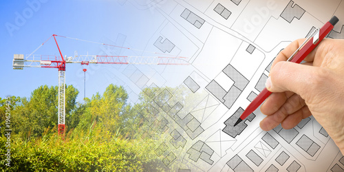 Fotomural Building a new city - concept image with and drawing an imaginary cadastral map