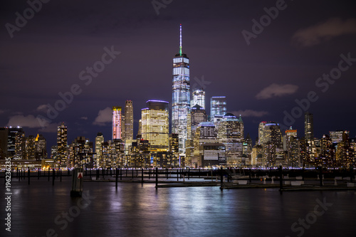 The lights of Lower Manhattan and the World Trade Center reflect off the water of the Hudson River, as seen from Hoboken, New Jersey Canvas Print