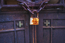 Old Rusty Lock On The Gates Of...