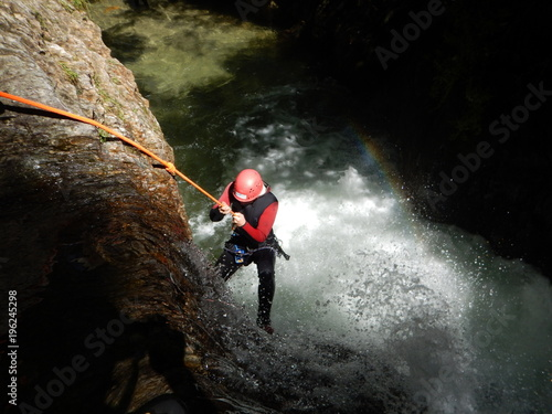 Canyoning - the young courageous girl abseiling into the canyon Canvas Print