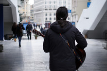 Street Guitar Player Playing A...