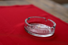 Empty Glass Ashtray On Red Tablecloth