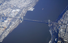 Aerial View Of The George Washington Bridge Over The Hudson River Between New York And New Jersey After A Winter Snow Storm In New York City
