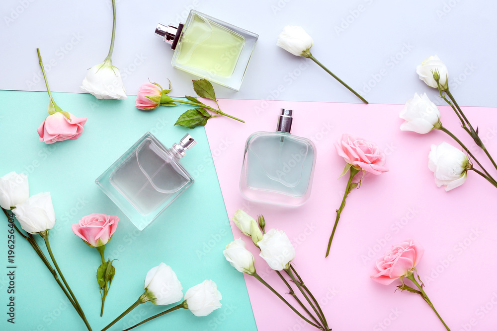 Fototapety, obrazy: Perfume bottles with flowers on colorful background