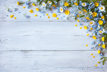 Spring And Summer Flowers Forget-me-nots, Buttercups, Daisies On A Wooden Background