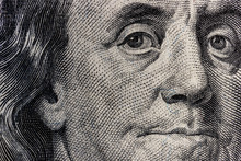 Closeup Of Ben Franklin On A O...