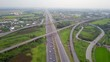 Footage clip of the aerial view of the traffic on a highway of the left-hand traffic system.