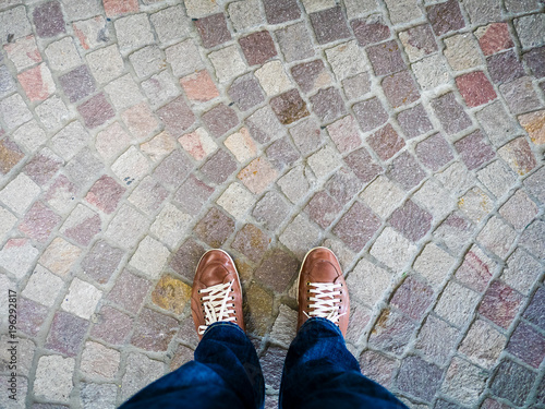 Spoed Fotobehang Buenos Aires point of view of leather shoes in ornate rock mosaic floor