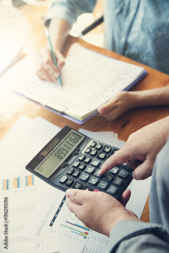 Business and finance concept of office working, Businessman using calculator to discussing sale analysis Chart - 196295016
