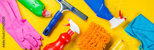 Cleaning concept - cleaning supplies on wood background Fototapet