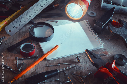 Foto op Aluminium Workbench with notebook and pencil in blue tone