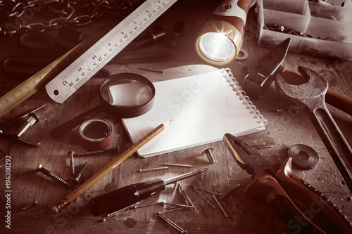 Workbench with notebook and pencil in sepia tone Wallpaper Mural