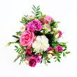 Composition of flowers in a pink hatbox. Tied with wide white ribbon and bow