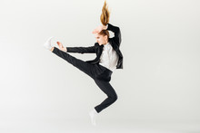 Female Karate Fighter Jumping ...