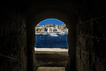 Watching The Harbour Through An Archway