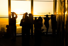 People Silhouettes Against A S...