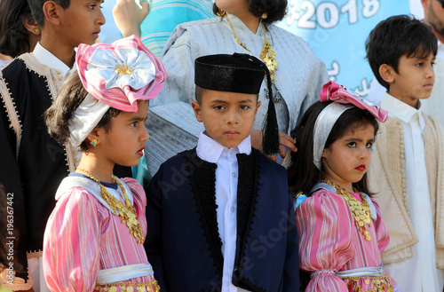 Libyan children participate in a street festival held to celebrate
