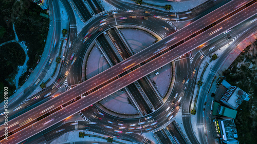 Obraz na plátně Expressway top view, Top view over the highway, expressway and motorway at night, Aerial view interchange of a city, Shot from drone, Expressway is an important infrastructure