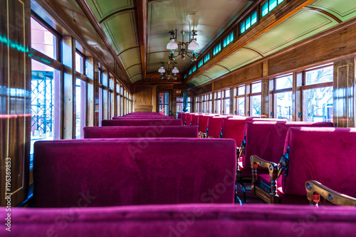 Fotografie, Obraz  Antique Passenger Car Interior with Red Louver Seats
