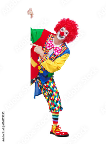 Vertical picture of a clown pointing to blank board
