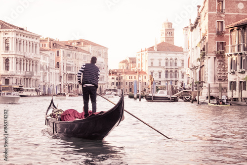 Spoed Fotobehang Gondolas Man on gondola in Venice , Italian street on water, Venetian taxi on water, Symbol of Italian Venice, Beautiful nooks in Venice, Italian street on water, Man on gondola in Venice