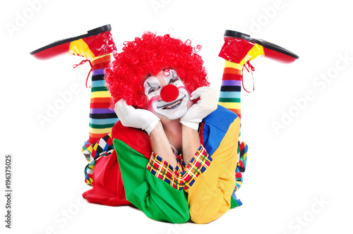 Photographie Happy clown  laying on the floor