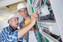 Tradesmen Installing A Distrib...