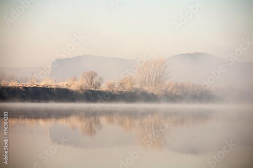 Fototapeta Morning on the river early morning fog obraz