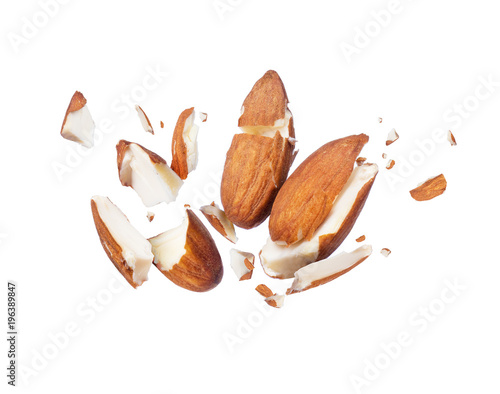 Photo Almonds is torn to pieces close-up, isolated on white background