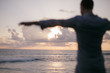 Back side of young man looking at the sea, vacations lifestyle concept. Sense of freedom. travel. Sunset at sea