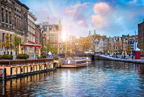 Photo Stands Amsterdam Channel in Amsterdam Netherlands houses river Amstel landmark