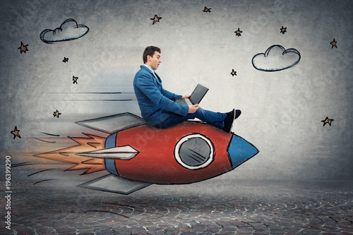 Fotografiet businessman's rocket speed