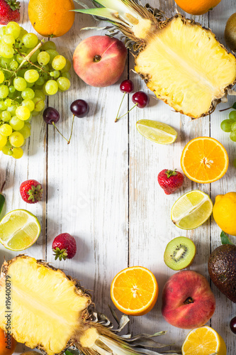 Fototapety, obrazy: Fruit and berries over white wooden table. Top view.