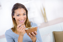 Young Woman Having Breakfast A...