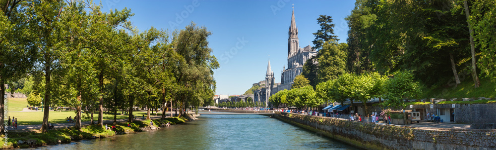 Fototapety, obrazy: Panoramic view of the city Lourdes - the Sanctuary of Our Lady of Lourdes, the Hautes-Pyrenees department in the Occitanie region in south-western France.